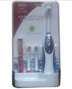 Электрическая зубная щетка ( с тремя сменными щетками )