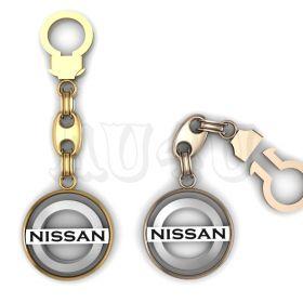 """Золотой брелок Ниссан """"Nissan""""."""