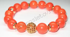 """Браслет из оранжевого коралла и позолоты """"Ягодка"""""""