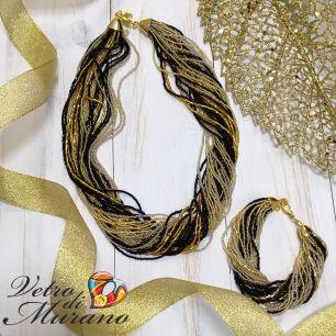 Ожерелье  из скрученного бисера  цвет черно-золотой 30 нитей
