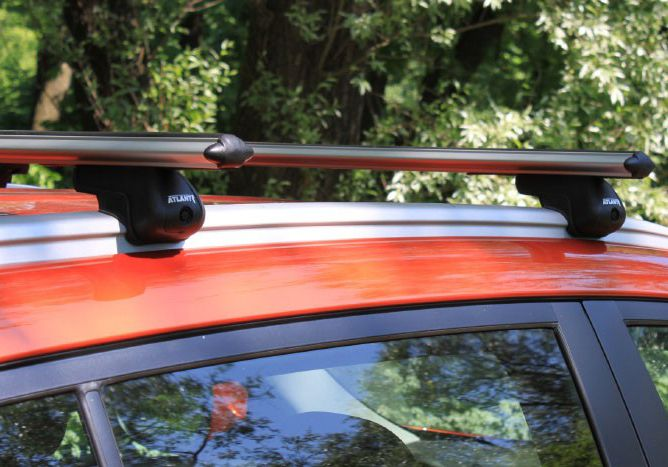 Багажник на крышу Kia Sportage III (SL) с интегрированными рейлингами, Атлант, аэродинамические дуги
