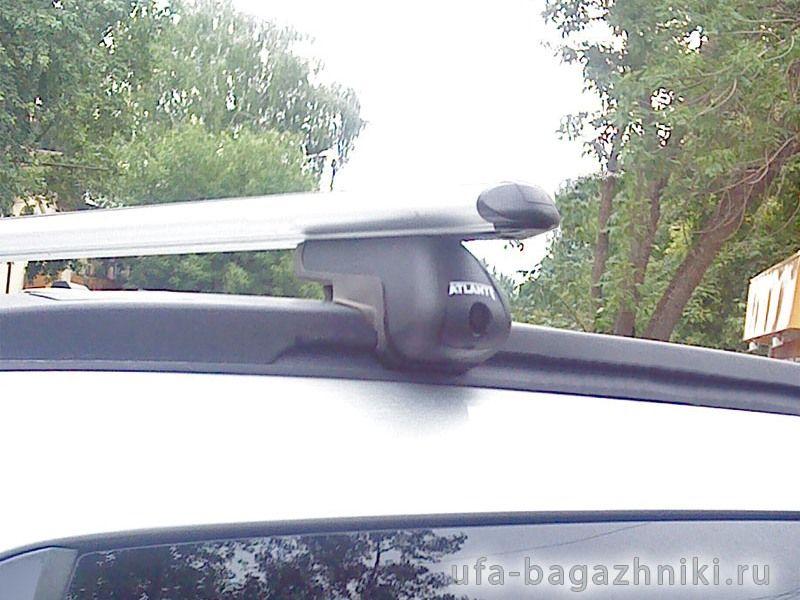 Багажник на крышу Opel Astra, аэродинамические дуги на интегрированные рейлинги, Атлант