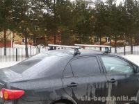 Багажник на крышу Toyota Corolla, Атлант: аэродинамические дуги и опоры типа Е