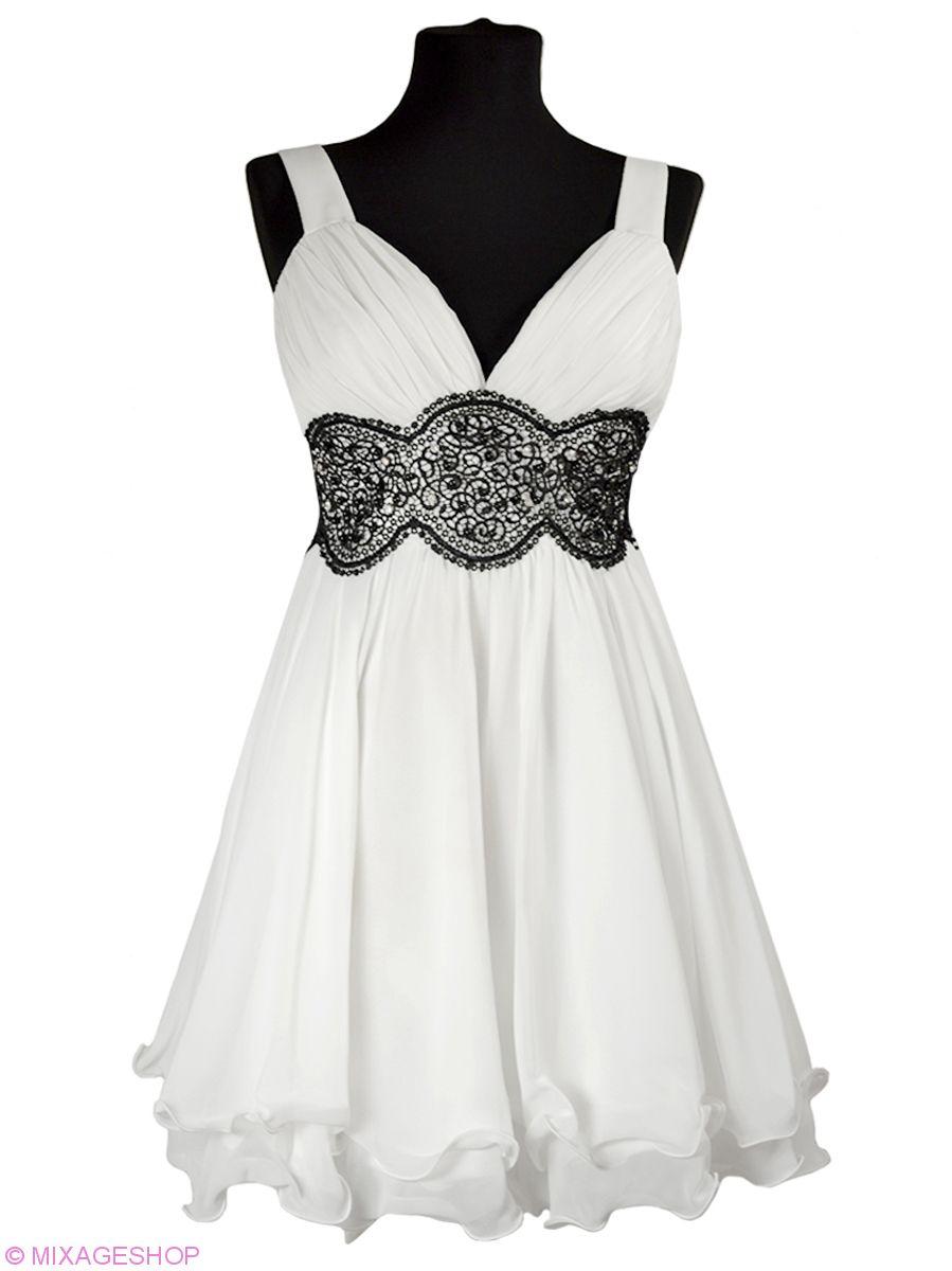 Платье из шифона украшено контрастной вышивкой