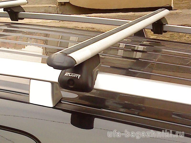 Багажник на крышу Toyota Land Cruiser, Атлант, аэродинамические дуги на рейлинги