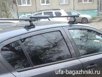 Универсальный багажник на крышу Opel Astra H, Муравей С-15,  стальные прямоугольные дуги