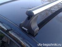 Багажник на крышу Renault Logan, Атлант, аэродинамические дуги, опора Е