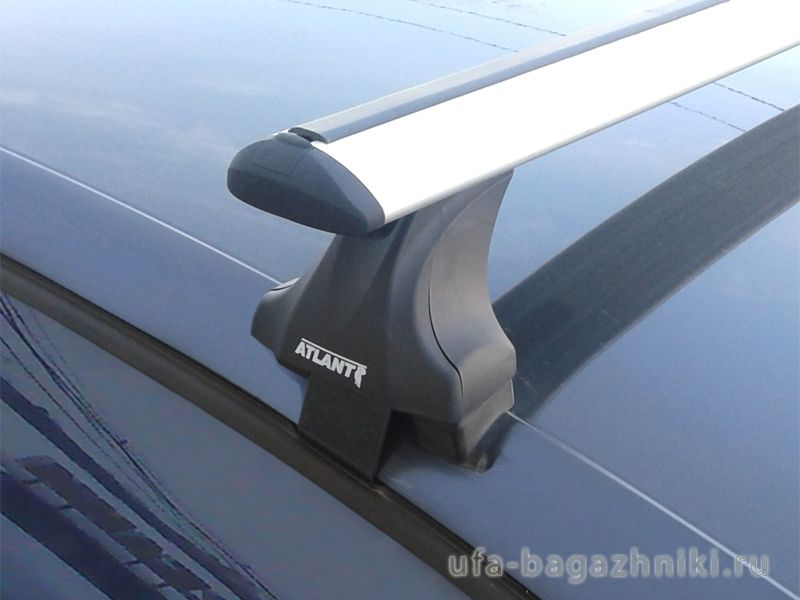 Багажник на крышу Volkswagen Polo sedan 2010-..., Атлант: крыловидные дуги и опоры типа Е