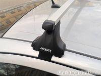 Багажник на крышу Chevrolet Aveo (T300) (4-dr sed.. 5-dr hatch.), Атлант, прямоугольные дуги