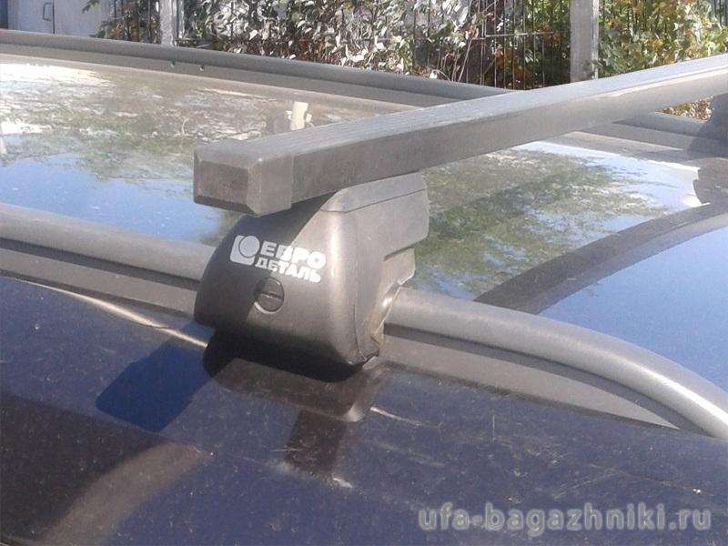 Багажник на интегрированные рейлинги Opel Astra H, универсал, Евродеталь, стальные прямоугольные дуги