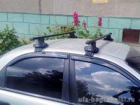 Универсальный багажник на крышу D-Lux 1 на ZAZ Sens / ZAZ Chance, стальные прямоугольные дуги