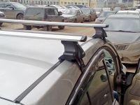 Универсальный багажник на крышу Nissan Tiida (sedan/hatchback 2004-2013) - D-Lux 1, крыловидные дуги