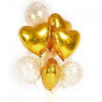 Композиция золотых сердец и прозрачных шаров с золотыми блёстками