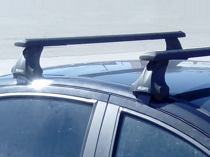 Багажник на крышу Nissan Juke, Атлант, крыловидные аэродуги (черный цвет)