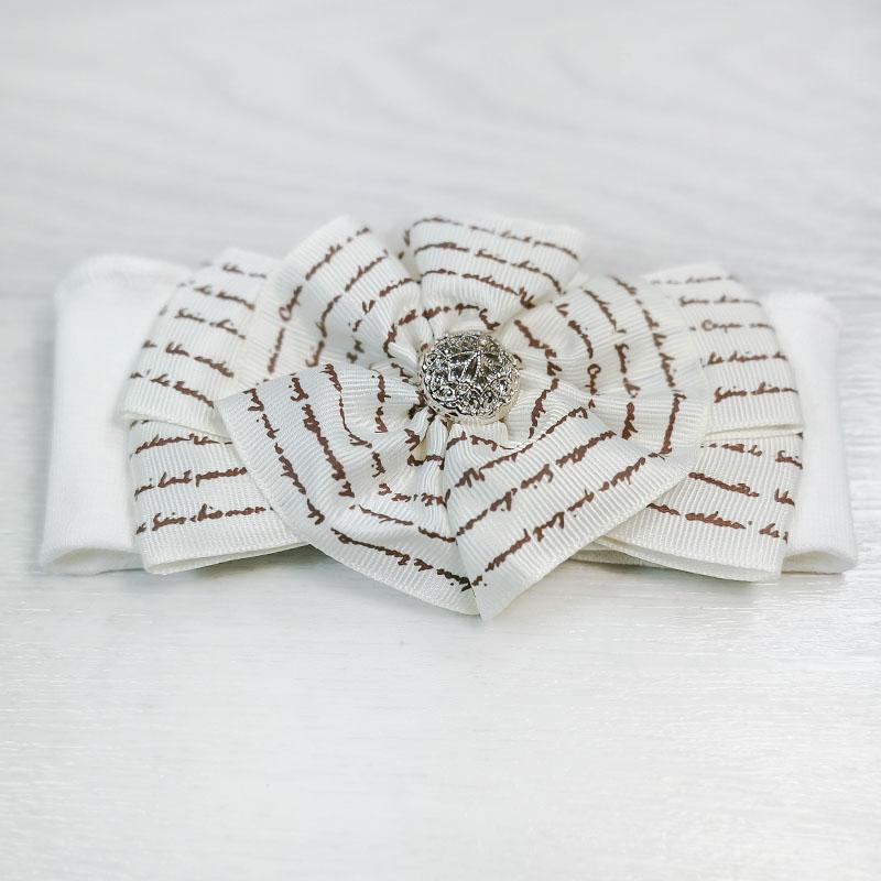 п1083-32 Повязка трикотажная с репсовым бантом Поэма молочная