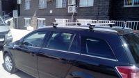 Багажник на крышу Opel Astra H, универсал с интегрированными рейлингами, Атлант, крыловидные аэродуги