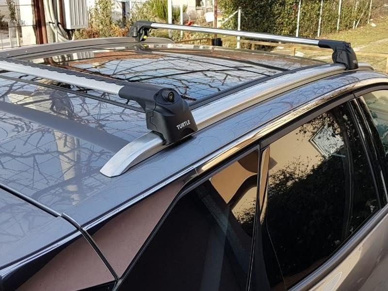 Багажник на крышу Peugeot 3008 2016-..., Turtle Air 2, аэродинамические дуги на интегрированные рейлинги (серебристый цвет)