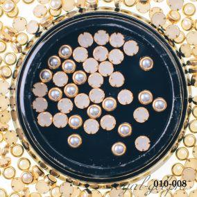 Жемчужины серебрянные в золотой оправе 1 гр.