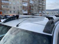 Багажник на крышу Renault Duster II (2015-...), аэродинамические дуги на рейлинги (серебристый цвет)
