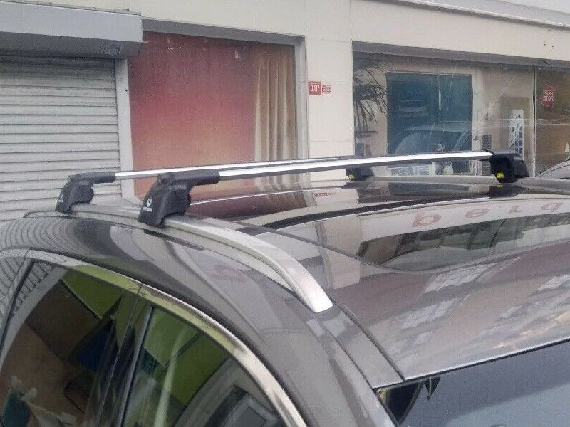 Багажник на крышу Renault Koleos 2016-..., Turtle Air 2, аэродинамические дуги на интегрированные рейлинги (серебристый цвет)