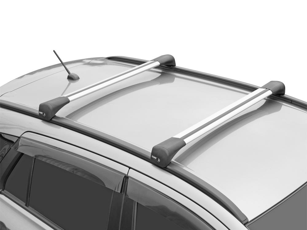 Багажник на крышу Suzuki SX4 2013-..., Lux Bridge, крыловидные дуги (серебристый цвет)