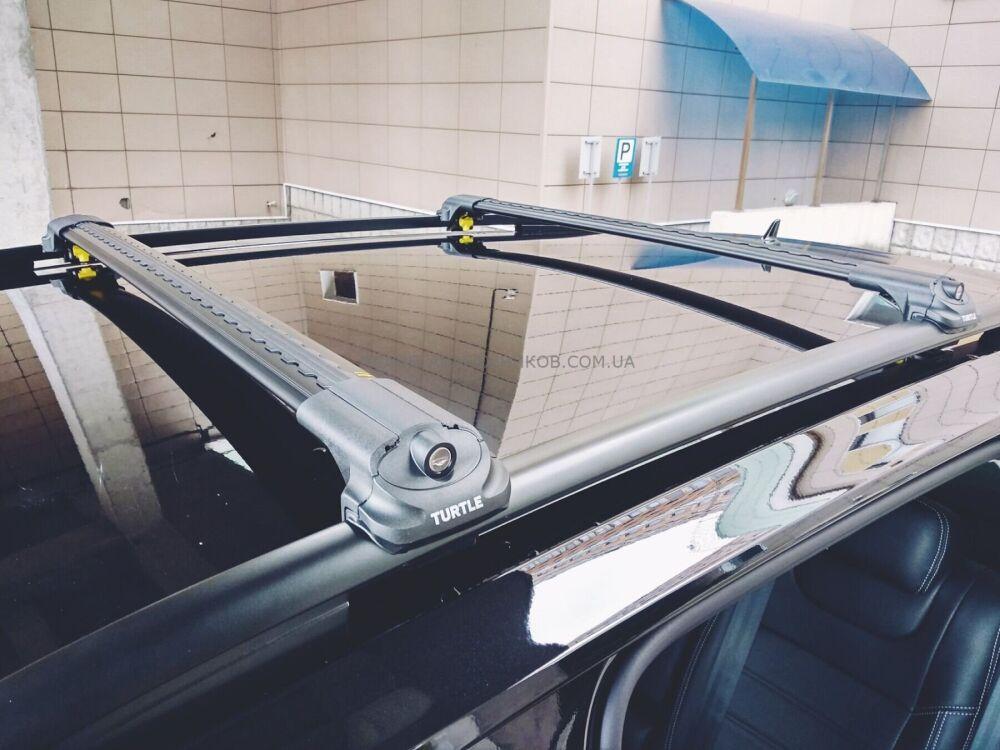 Багажник на крышу Nissan Qashqai, Turtle Air 1, аэродинамические дуги на рейлинги (черный цвет)