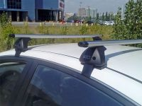 Багажник на крышу Nissan Almera 2012-..., Евродеталь, аэродинамические дуги