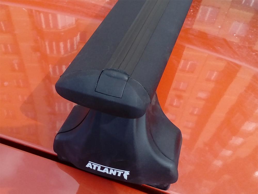 Багажник на крышу Renault Logan, Атлант, крыловидные дуги (черный цвет), опора Е