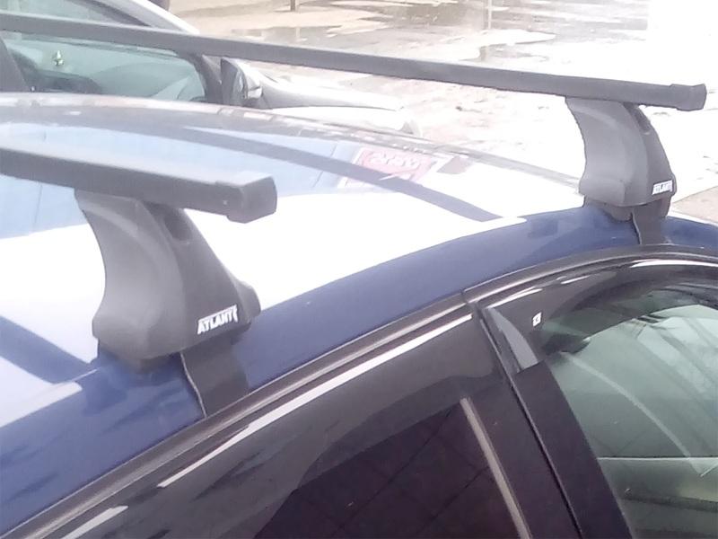 Багажник на крышу Renault Megane 3, Атлант, стальные прямоугольные дуги (в пластике)