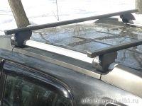 Багажник на крышу - стальные прямоугольные дуги на рейлинги Kia Sportage 2004-2010, Евродеталь