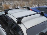 Багажник на крышу Toyota Hilux, Евродеталь, аэродинамические дуги (черный цвет)