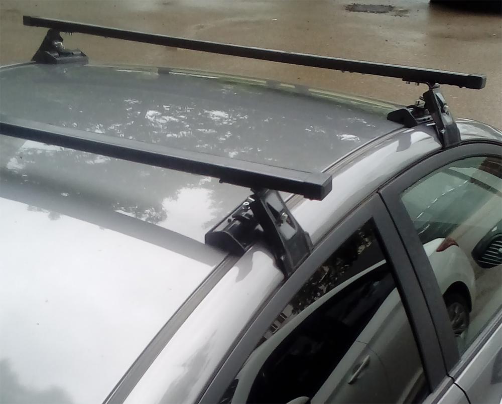 Универсальный багажник на крышу Hyundai Solaris 2011-17, Евродеталь, вид А, стальные прямоугольные дуги