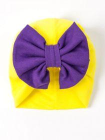 00-0020571  Чалма трикотажная для девочки с фиолетовым бантом, желтый