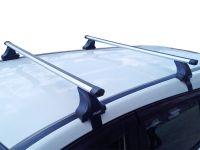 Багажник на крышу Kia Rio (c 2017г, sedan), Атлант, аэродинамические дуги Эконом, опора Е
