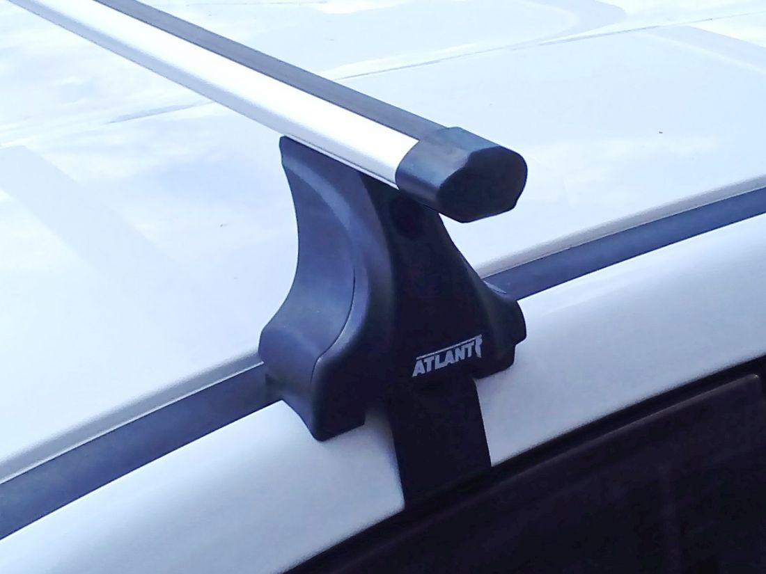 Багажник на крышу Kia Sportage (c 2016г, без рейлингов), Атлант, аэродинамические дуги Эконом, опора Е