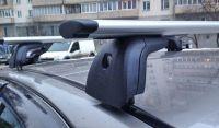 Багажник на крышу Opel Corsa D 2006-..., Amos Beta, крыловидные дуги