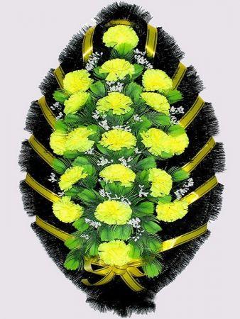 Фото Ритуальный венок из искусственных цветов #1 желтый из гвоздик и зелени